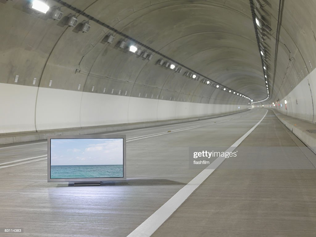 Flat TV placed in tunnel : Stock Photo