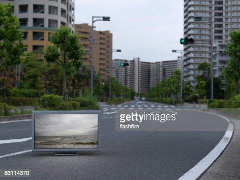 Flat TV placed in urban street : Stock Photo