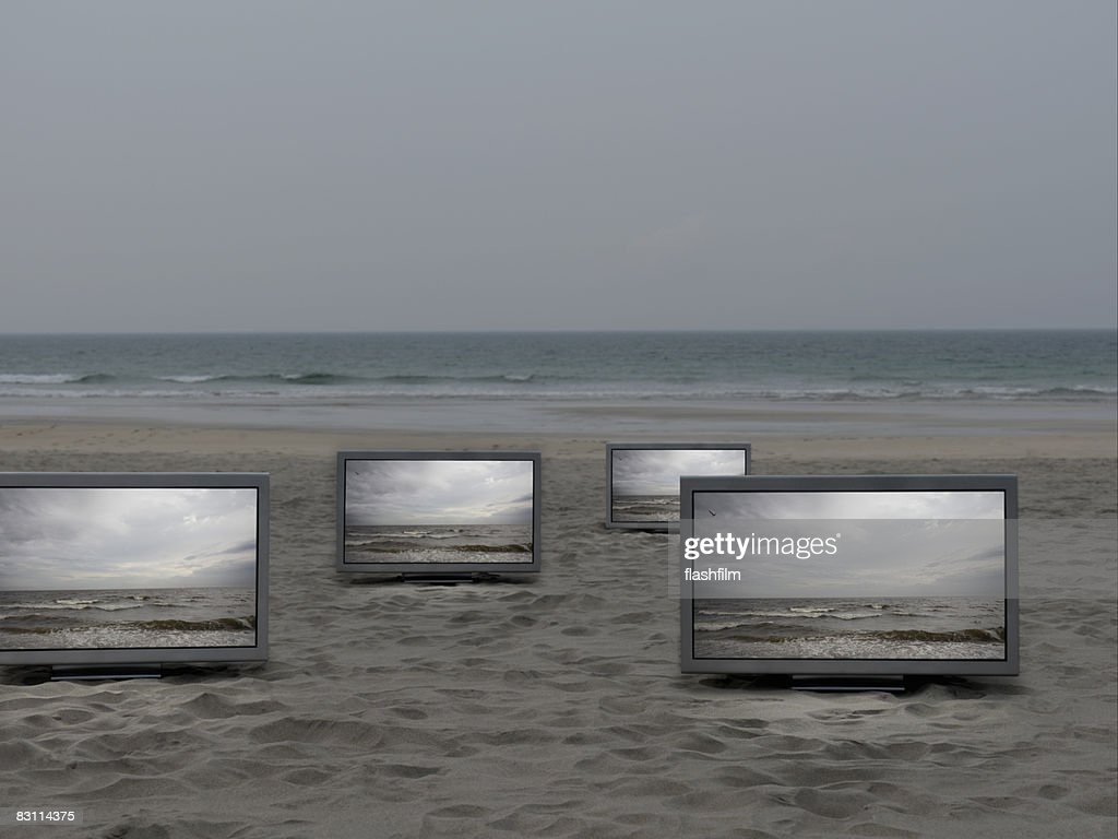 Flat TV placed on the beatch : Stock Photo