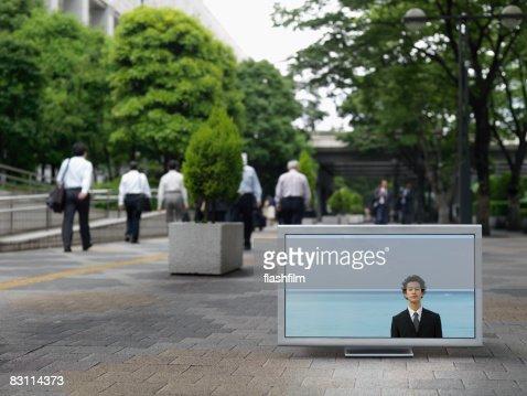 Flat TV placed on urban street : Stock Photo