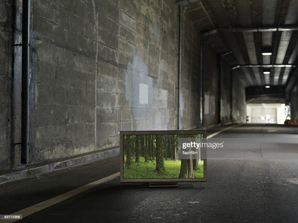 Flat TV placed on Urban underground street : Stock Photo
