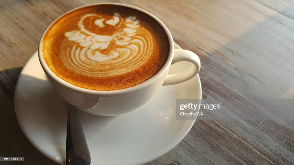 Flat white coffee drink on wooden table : Stock Photo