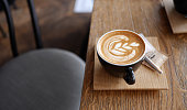 Flat white coffee in modern coffee shop