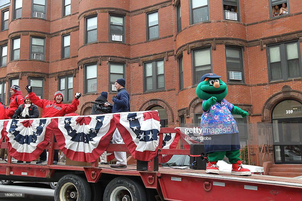 A flatbed carrying Wally and staff precedes the Red Sox equipment truck down Massachusetts Avenue. The Red Sox equipment truck gets packed and leaves Boston for Florida, on Tuesday, Feb. 5, 2013.