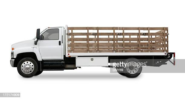 Flatbed truck with side rails isolated on white background.