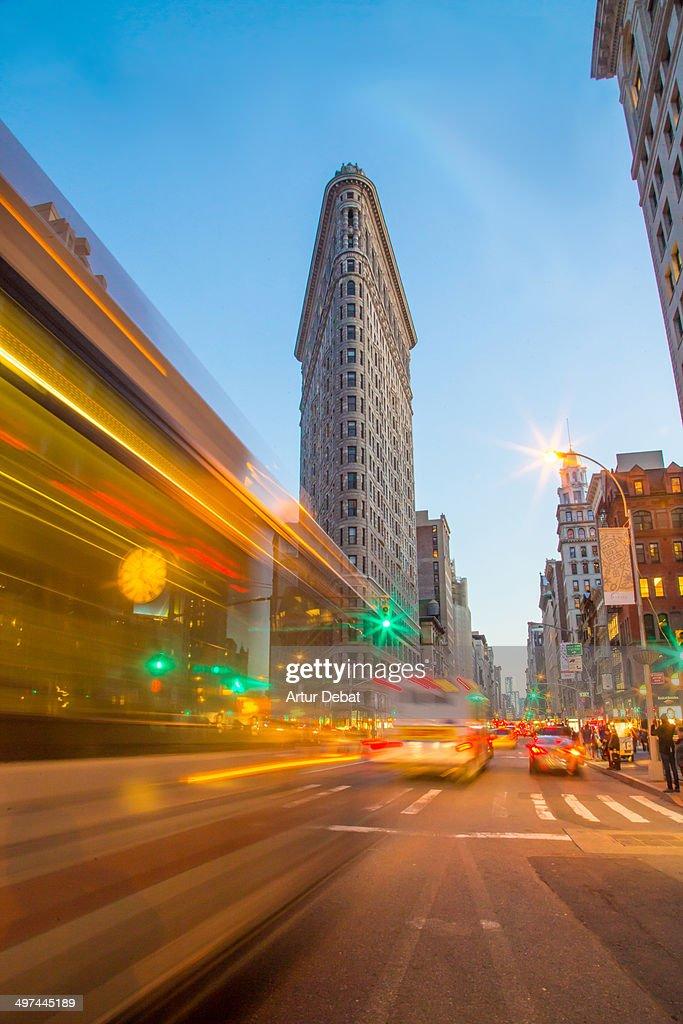 Flatiron building at night with traffic lights. NY