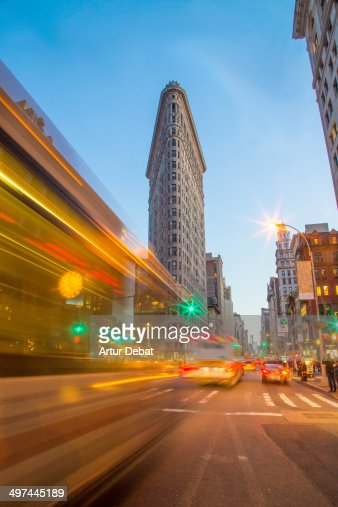 Flatiron building at night with traffic lights. NY