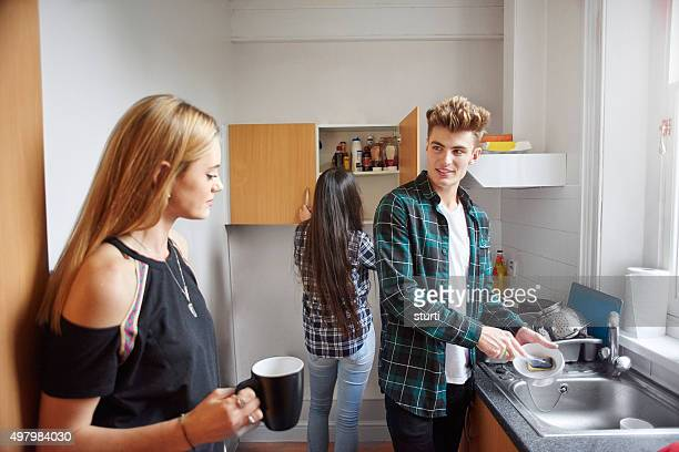 flatmates washing dishes in the kitchen.