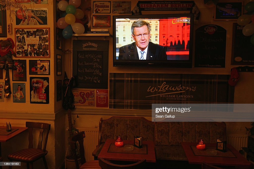 A flat-screen television shows German President Christian Wulff responding to critics in a television interview in a near-empty pub on January 4, 2011 in Berlin, Germany. Wulff has come under increasing pressure to resign following reports that he personally intervened in attempts to prevent journalists from writing about aspects of his personal life, including a recent call to Editor-in-Chief Kai Diekmann of Bild Zeitung, in which he threatened Diekmann with legal action should the paper publish a story about Wulff's personal finance conduct while Wulff was prime minister of Lower Saxony. These accusations come on the heels of revelations of cozy relationships between Wulff and businessmen in Lower Saxony that included free holidays and low interest loans.