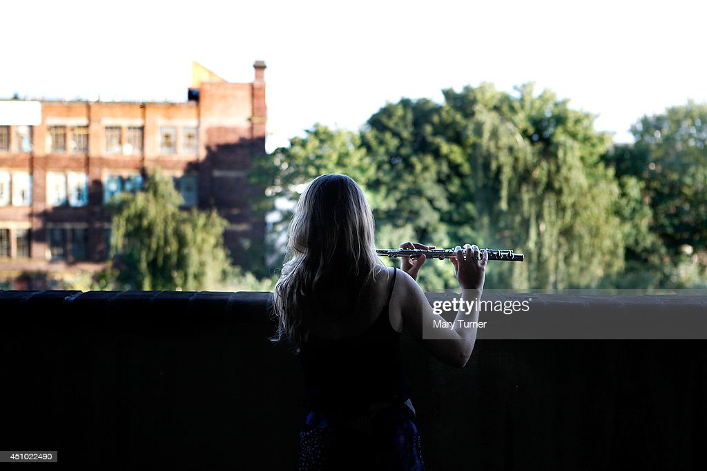 A flautist from The MultiStory Orchestra practices before a performance of Jean Sibelius' 5th Symphony at the Peckham Rye Car Park on June 21 2014 in...