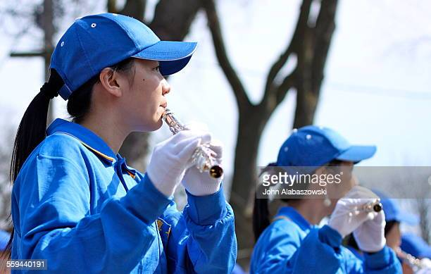 Flautist in a marching band during a parade