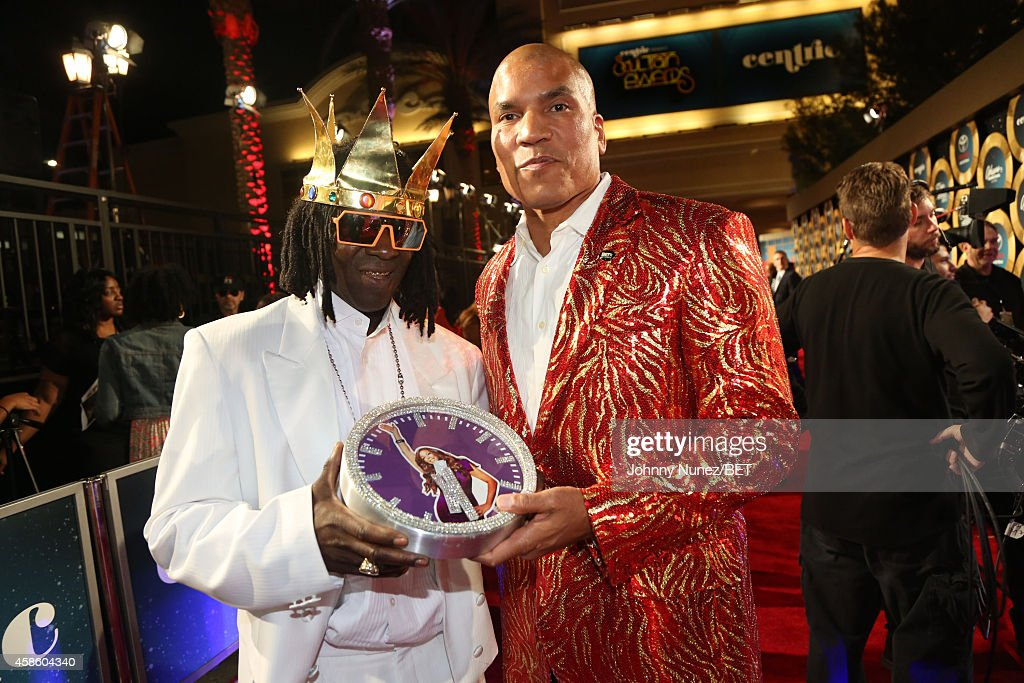 Flava Flav and Paxton Baker attend 2014 Soul Train Music Awards on November 7, 2014 in Las Vegas, Nevada.
