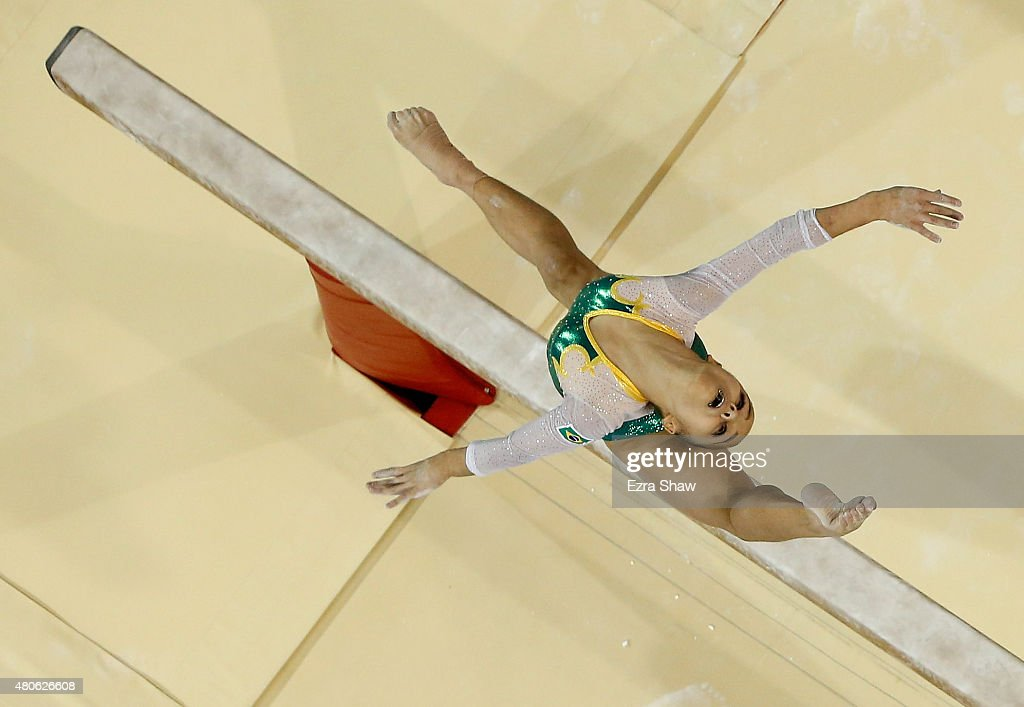 Flavia Lopes Saraiva of Brazil competes on the balance beam during the women's all around artistic gymnastics final on Day 3 of the Toronto 2015 Pan...