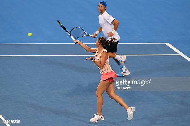 Flavia Pennetta and Fabio Fognini of Italy contest the mixed doubles match against Serena Williams and John Isner of the United States during day two...