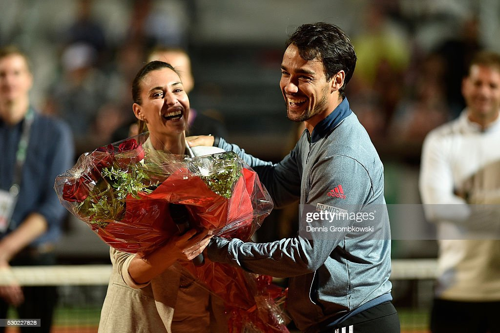 <a gi-track='captionPersonalityLinkClicked' href=/galleries/search?phrase=Flavia+Pennetta&family=editorial&specificpeople=220518 ng-click='$event.stopPropagation()'>Flavia Pennetta</a> and <a gi-track='captionPersonalityLinkClicked' href=/galleries/search?phrase=Fabio+Fognini&family=editorial&specificpeople=656601 ng-click='$event.stopPropagation()'>Fabio Fognini</a> of Italy react as <a gi-track='captionPersonalityLinkClicked' href=/galleries/search?phrase=Flavia+Pennetta&family=editorial&specificpeople=220518 ng-click='$event.stopPropagation()'>Flavia Pennetta</a> waves bye after retiring from tennis on Day Three of The Internazionali BNL d'Italia 2016 on May 10, 2016 in Rome, Italy.