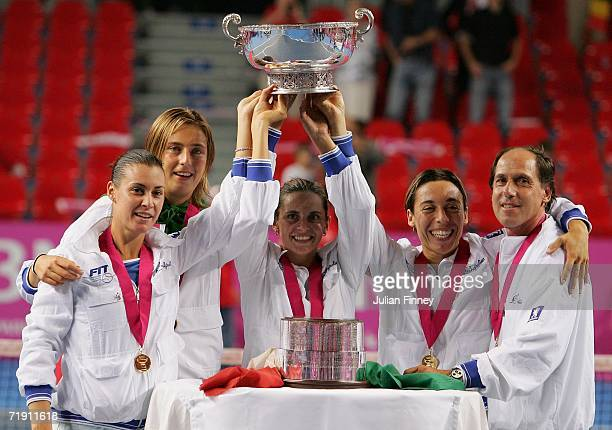 Flavia Pennetta Mara Santangelo Roberta Vinci Francesca Schiavone and Coach Corrado Barazzutti of Italy celebrate with the trophy after defeating...