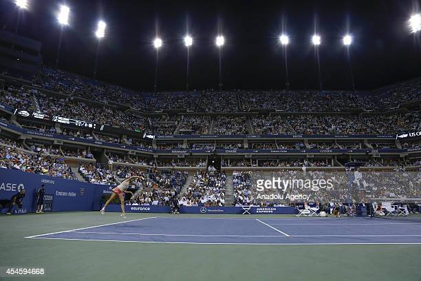 Flavia Pennetta of Italia returns a shot against Serena Williams of United States during women's singles quarterfinal match on Day Ten of the 2014 US...
