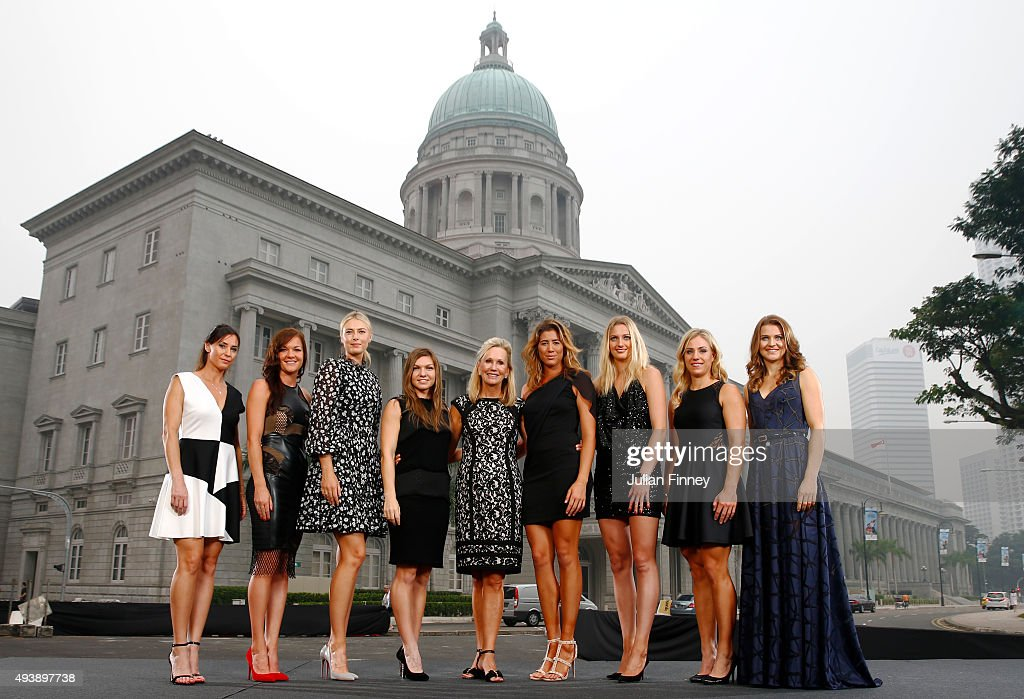 Flavia Pennetta of Italy, Agnieszka Radwanska of Poland, Maria Sharapova of Russia, Simona Halep of Romania, WTA President Micky Lawler, Garbine Muguruza of Spain, Petra Kvitova of Czech Republic, Angelique Kerber of Germany and Lucie Safarova of Czech Republic pose for the official photo of the BNP Paribas WTA Finals at the National Gallery on October 23, 2015 in Singapore.