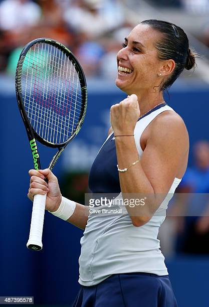 Flavia Pennetta of Italy celebrates after defeating Petra Kvitova of Czech Republic during their Women's Singles Quarterfinals match on Day Ten of...