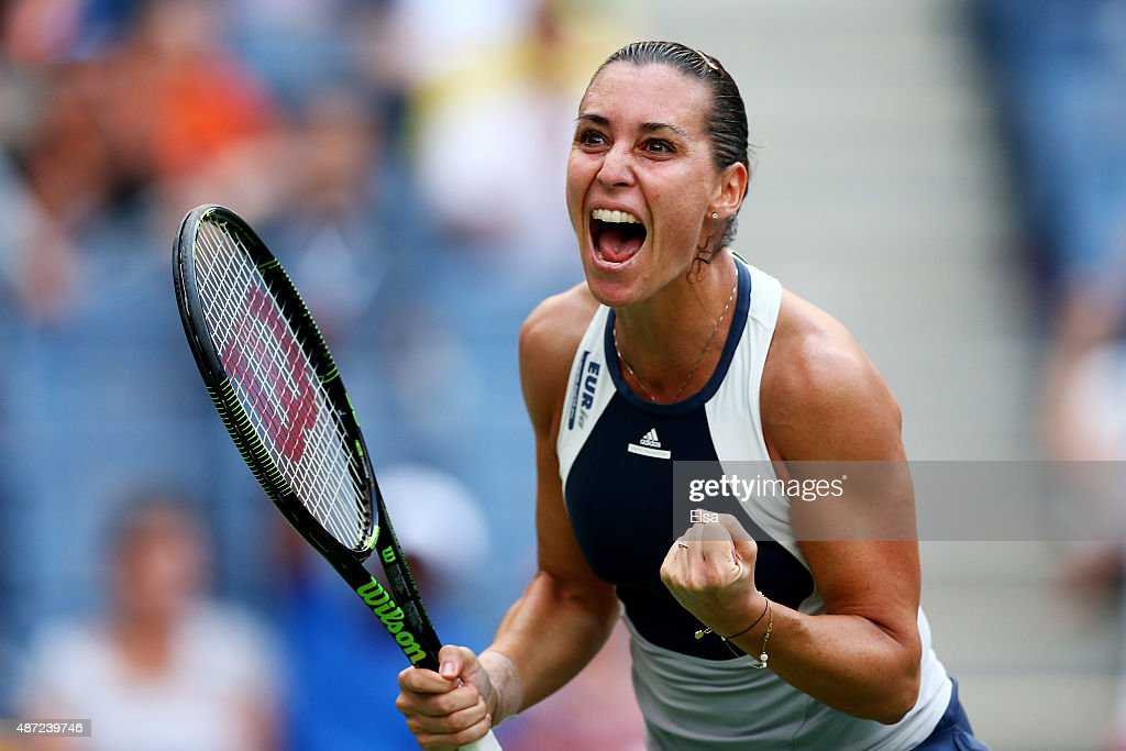 <a gi-track='captionPersonalityLinkClicked' href=/galleries/search?phrase=Flavia+Pennetta&family=editorial&specificpeople=220518 ng-click='$event.stopPropagation()'>Flavia Pennetta</a> of Italy celebrates after defeating Samantha Stosur of Australia during their Women's Singles Fourth Round match on Day Eight of the 2015 US Open at the USTA Billie Jean King National Tennis Center on September 7, 2015 in the Flushing neighborhood of the Queens borough of New York City.