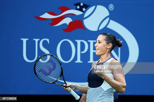 Flavia Pennetta of Italy celebrates after defeating Samantha Stosur of Australia during their Women's Singles Fourth Round match on Day Eight of the...