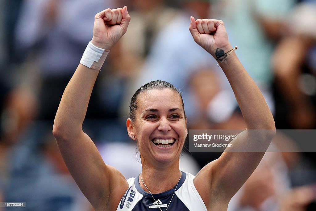 <a gi-track='captionPersonalityLinkClicked' href=/galleries/search?phrase=Flavia+Pennetta&family=editorial&specificpeople=220518 ng-click='$event.stopPropagation()'>Flavia Pennetta</a> of Italy celebrates after defeating Simona Halep of Romania in their Women's Singles Semifinals match on Day Twelve of the 2015 US Open at the USTA Billie Jean King National Tennis Center on September 11, 2015 in the Flushing neighborhood of the Queens borough of New York City. Pennetta defeated Halep 6-1, 6-3.