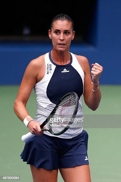 Flavia Pennetta of Italy celebrates after winning the first set against Roberta Vinci of Italy during their Women's Singles Final match on Day...