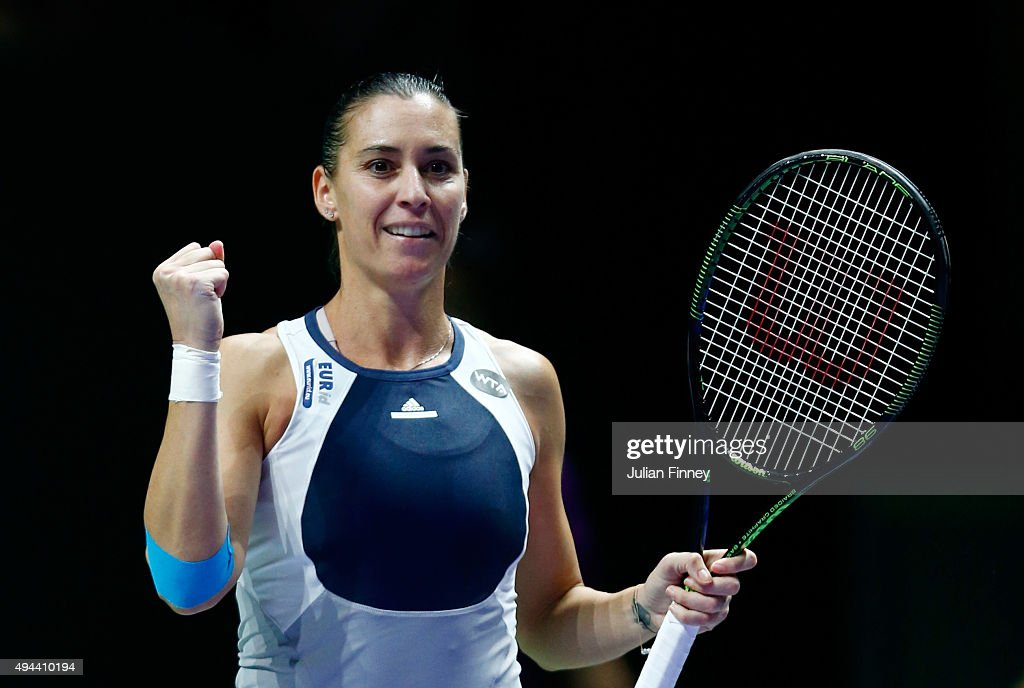 <a gi-track='captionPersonalityLinkClicked' href=/galleries/search?phrase=Flavia+Pennetta&family=editorial&specificpeople=220518 ng-click='$event.stopPropagation()'>Flavia Pennetta</a> of Italy celebrates match point against Agnieszka Radwanska of Poland in a round robin match during the BNP Paribas WTA Finals at Singapore Sports Hub on October 27, 2015 in Singapore.