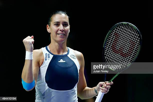 Flavia Pennetta of Italy celebrates match point against Agnieszka Radwanska of Poland in a round robin match during the BNP Paribas WTA Finals at...
