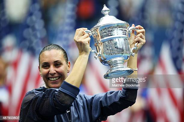 Flavia Pennetta of Italy celebrates with the winner's trophy after defeating Roberta Vinci of Italy during their Women's Singles Final match on Day...