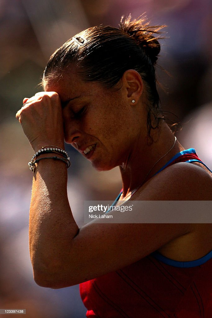 <a gi-track='captionPersonalityLinkClicked' href=/galleries/search?phrase=Flavia+Pennetta&family=editorial&specificpeople=220518 ng-click='$event.stopPropagation()'>Flavia Pennetta</a> of Italy reacts after a point against Maria Sharapova of Russia during Day Five of the 2011 US Open at the USTA Billie Jean King National Tennis Center on September 2, 2011 in the Flushing neighborhood of the Queens borough of New York City.