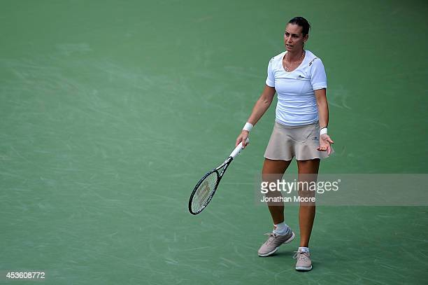 Flavia Pennetta of Italy reacts during a matcha against Serena Williams on day 6 of the Western Southern Open at the Linder Family Tennis Center on...