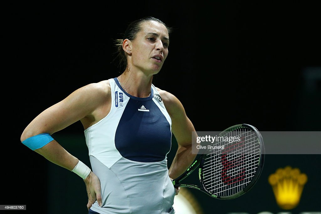 <a gi-track='captionPersonalityLinkClicked' href=/galleries/search?phrase=Flavia+Pennetta&family=editorial&specificpeople=220518 ng-click='$event.stopPropagation()'>Flavia Pennetta</a> of Italy reacts in her round robin match against Maria Sharapova of Russia during the BNP Paribas WTA Finals at Singapore Sports Hub on October 29, 2015 in Singapore.