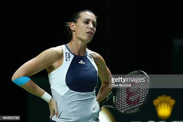 Flavia Pennetta of Italy reacts in her round robin match against Maria Sharapova of Russia during the BNP Paribas WTA Finals at Singapore Sports Hub...