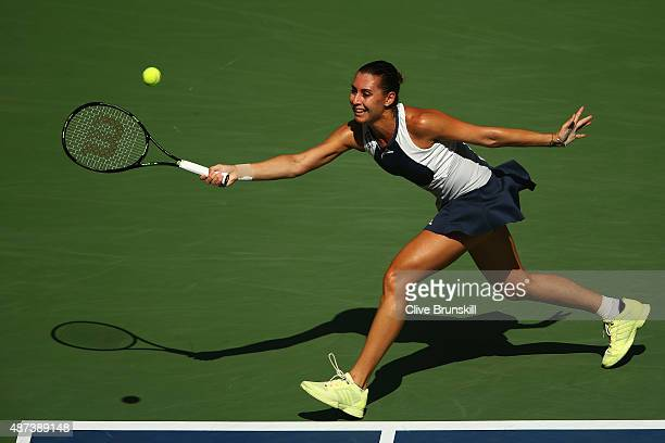 Flavia Pennetta of Italy returns a shot to Petra Kvitova of Czech Republic during their Women's Singles Quarterfinals match on Day Ten of the 2015 US...