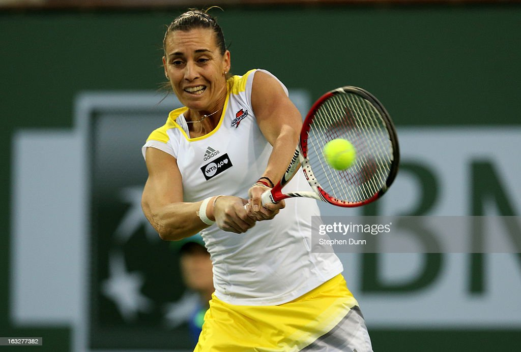 Flavia Pennetta of Italy returns to Francesca Schia of Italy during day 1 of the BNP Paribas Open at Indian Wells Tennis Garden on March 6, 2013 in Indian Wells, California. .