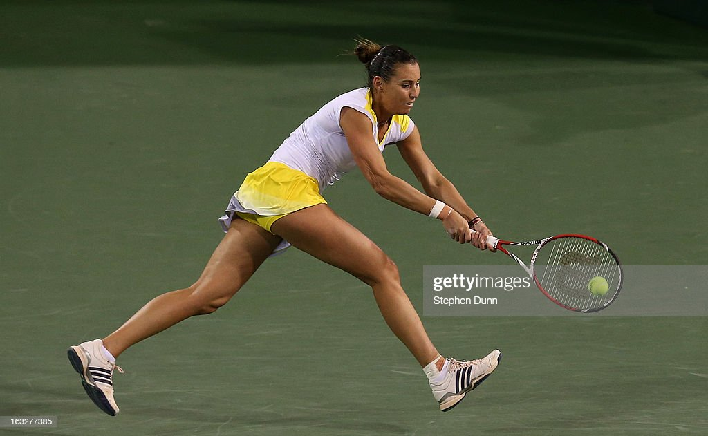 <a gi-track='captionPersonalityLinkClicked' href=/galleries/search?phrase=Flavia+Pennetta&family=editorial&specificpeople=220518 ng-click='$event.stopPropagation()'>Flavia Pennetta</a> of Italy returns to Francesca Schia of Italy during day 1 of the BNP Paribas Open at Indian Wells Tennis Garden on March 6, 2013 in Indian Wells, California. .