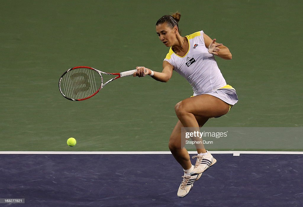 Flavia Pennetta of Italy returns to Francesca Schiavone of Italy during day 1 of the BNP Paribas Open at Indian Wells Tennis Garden on March 6, 2013 in Indian Wells, California. .