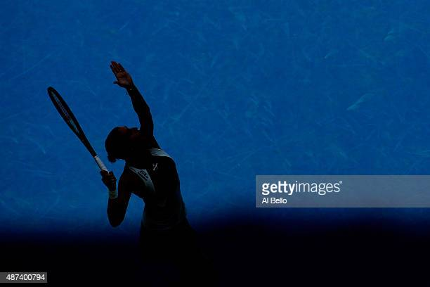 Flavia Pennetta of Italy serves to Petra Kvitova of Czech Republic during their Women's Singles Quarterfinals match on Day Ten of the 2015 US Open at...