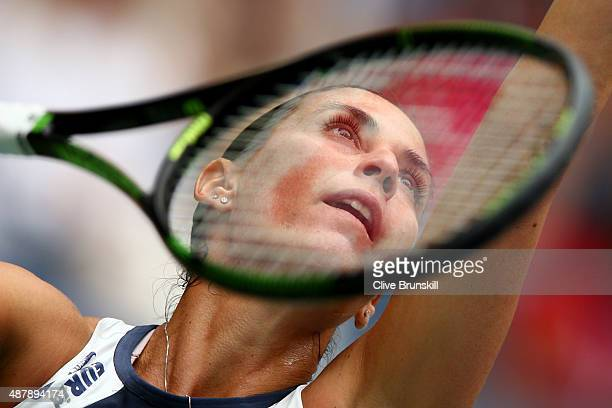 Flavia Pennetta of Italy serves to Roberta Vinci of Italy during their Women's Singles Final match on Day Thirteen of the 2015 US Open at the USTA...