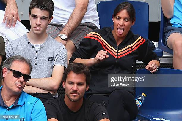 Flavia Pennetta of Italy supports Fabio Fognini of Italy in his match against Alexandr Dolgopolov of Ukraine during day four of the Mutua Madrid Open...