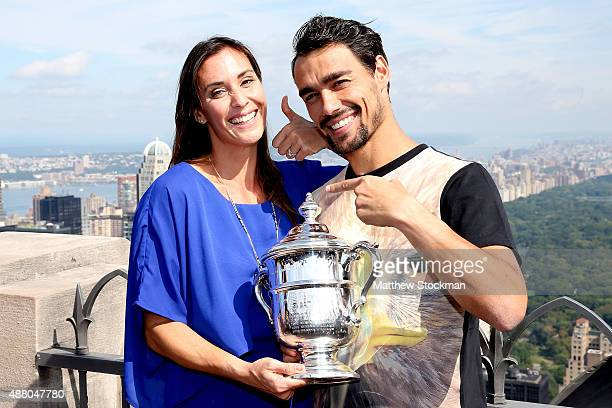 Flavia Pennetta of Italy the 2015 US Open Women's Singles champion poses with her fiance Fabio Fognini and the winner's trophy at the Top of the Rock...