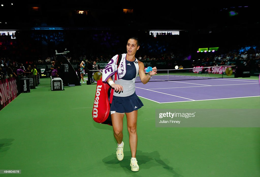 Flavia Pennetta of Italy walks off court after being defeated by Maria Sharapova of Russia in a staight set victory during the BNP Paribas WTA Finals at Singapore Sports Hub on October 29, 2015 in Singapore.