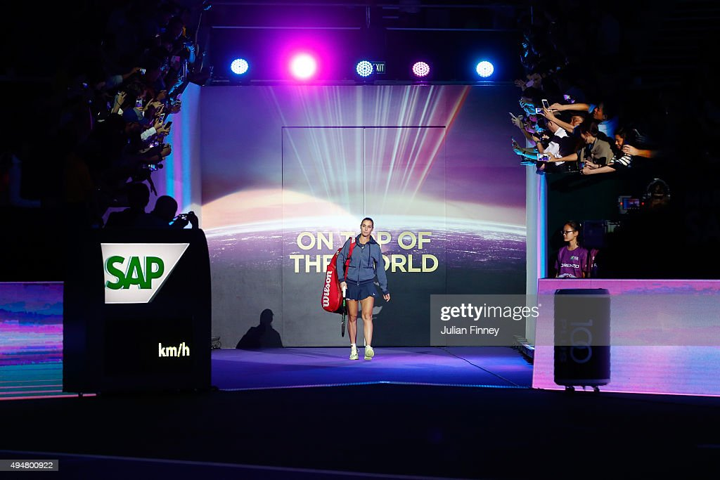 Flavia Pennetta of Italy walks out onto the court prior to her round robin match against Maria Sharapova of Russia during the BNP Paribas WTA Finals at Singapore Sports Hub on October 29, 2015 in Singapore.