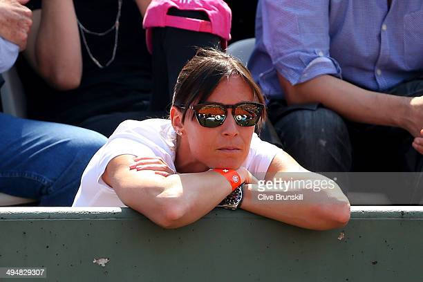 Flavia Pennetta of Italy watches Fabio Fognini of Italy during his men's singles match against Gael Monfils of France on day seven of the French Open...