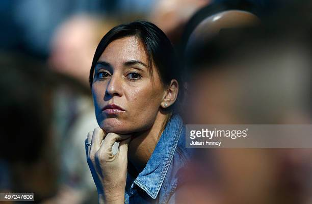 Flavia Pennetta of Italy watches the men's doubles match between Fabio Fognini and Simone Bolelli of Italy and Jamie Murray of Great Britain and John...