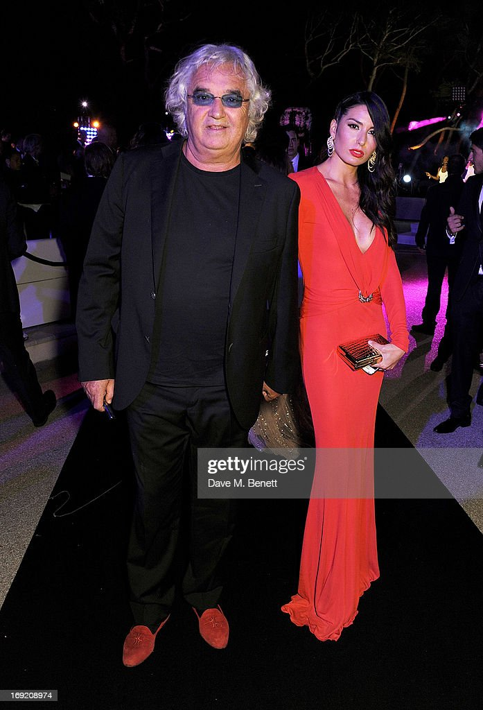 <a gi-track='captionPersonalityLinkClicked' href=/galleries/search?phrase=Flavio+Briatore&family=editorial&specificpeople=220211 ng-click='$event.stopPropagation()'>Flavio Briatore</a> (L) and <a gi-track='captionPersonalityLinkClicked' href=/galleries/search?phrase=Elisabetta+Gregoraci&family=editorial&specificpeople=606805 ng-click='$event.stopPropagation()'>Elisabetta Gregoraci</a> attend the de Grisogono Party during the 66th International Cannes Film Festival at Hotel Du Cap on May 21, 2013 in Antibes, France.