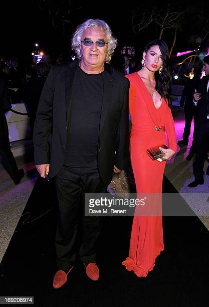 Flavio Briatore and Elisabetta Gregoraci attend the de Grisogono Party during the 66th International Cannes Film Festival at Hotel Du Cap on May 21...
