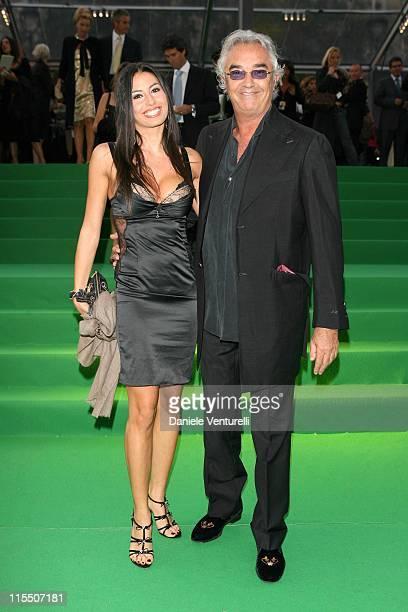 Flavio Briatore and Elisabetta Gregoraci during United Colors of Benetton 40th Anniversary Fashion Show at Centre Pompidou in Paris France