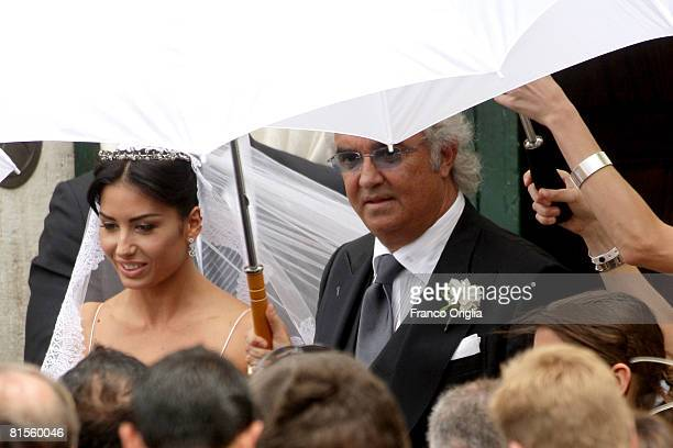 Flavio Briatore and Elisabetta Gregoraci leave the church of Santo Spirito di Sassia at the end of their wedding ceremony on June 14 2008 in Rome...